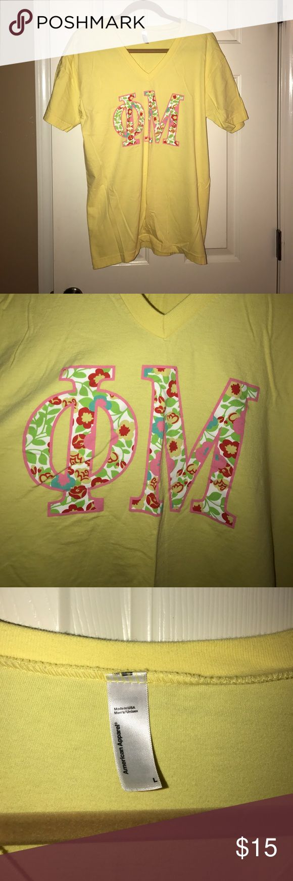 Yellow Phi Mu v-neck letter T-Shirt American Apparel V-Neck t-shirt with printed, floral Greek Phi Mu letters. Perfect for sorority events or casual wear. I have this shirt in a Large and a 2XL! American Apparel Tops Tees - Short Sleeve
