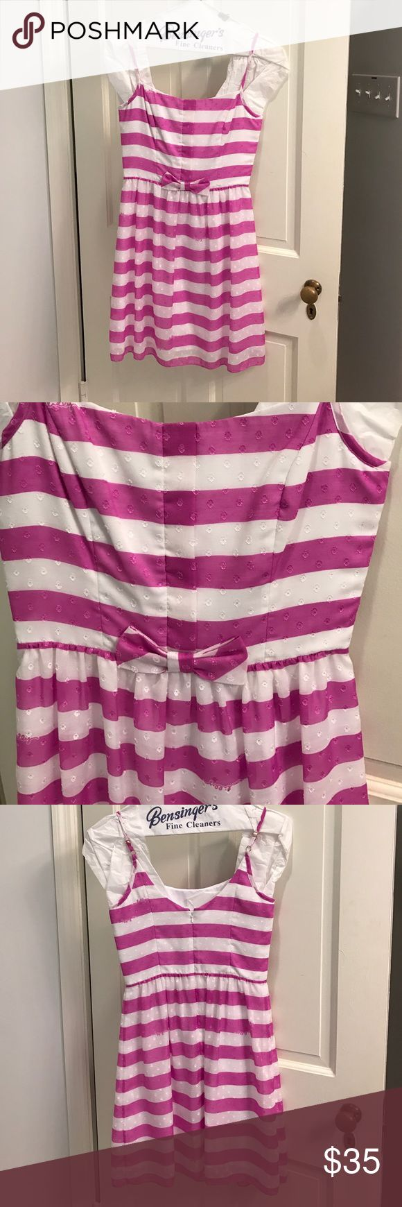 Lilly Pulitzer striped fuchsia/white dress size 2 Spaghetti strap Lilly Pulitzer sundress with fuchsia and white stripes. Size 2. Straps are adjustable. Bow detail on front waistband. Worn once and dry cleaned! Let me know if you have any questions! Lilly Pulitzer Dresses