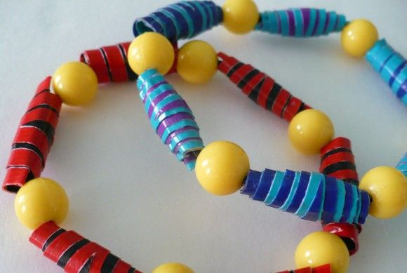 Duct tape roll up beads bracelet! This could be simplified for a kid using scissors instead of a knife. Could be fun! And no gluey mess!