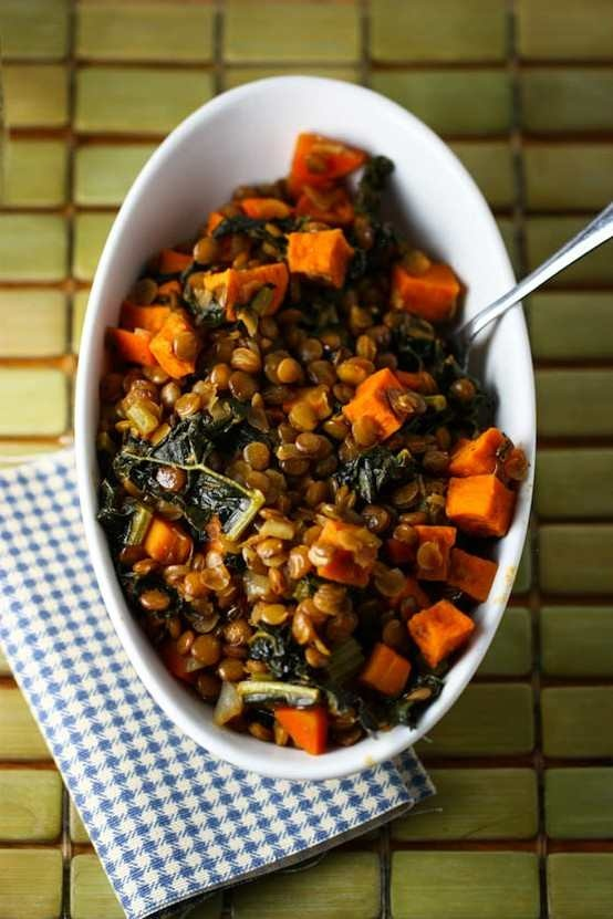 Spicy lentils with sweet potatoes and kale. this was delicious and filling; use about 3/4 c lentils and a bit more broth