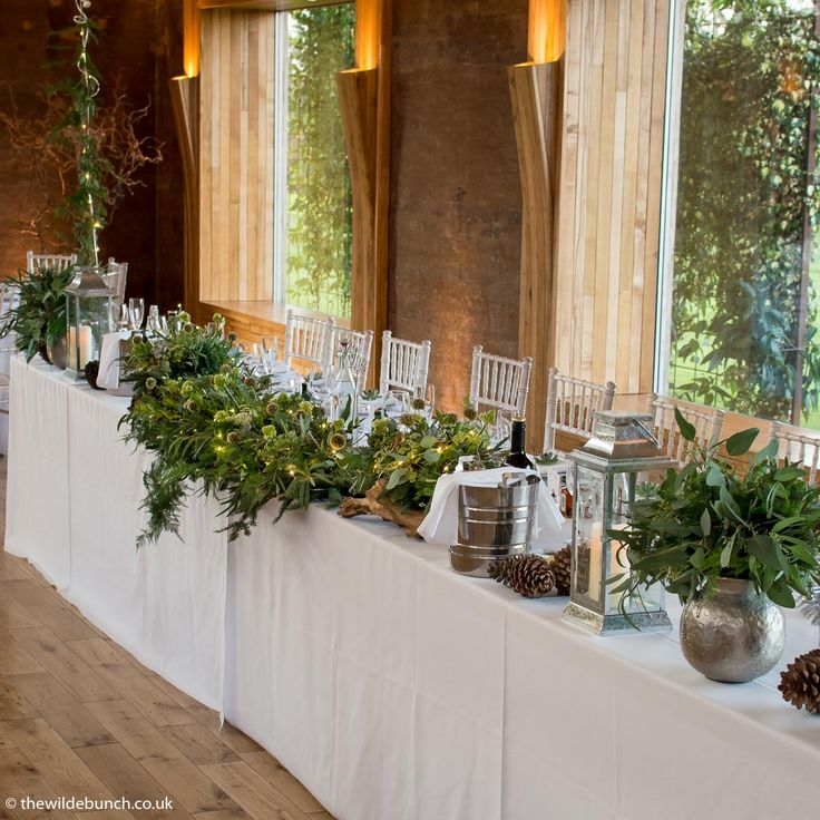 A winter top table design at Elmore Court by Bristol florists, The Wilde Bunch