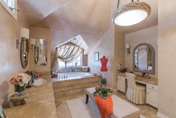 Feminine Touch - Kevin Costner's Former Mansion Back on the Market   - This vaulted guest room boasts a simple, comforting design.