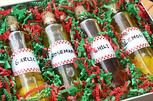 DIY Infused Olive Oils for gifts - Recipe for Lemon-Infused Olive Oil, Rosemary-Infused Olive Oil, Chili-Infused Olive Oil, and Garlic-Infused Olive Oil.
