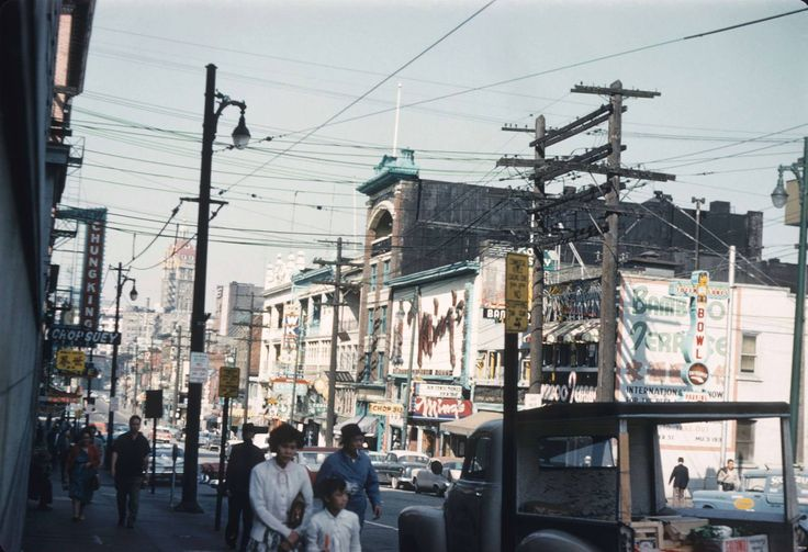 100 Block of East Pender, Looking West - 1961   Some of the businesses pictured in this photo include Bamboo Terrace, Mings and Chung King Chop Suey, among others. The Sun Tower appears in the background. Also note that Pender street here is a one-way street.
