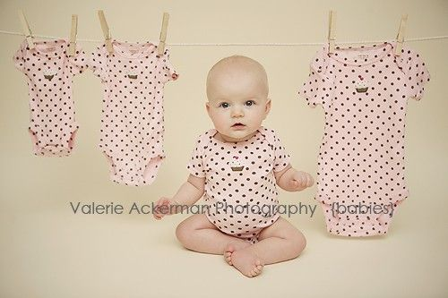 Buying the same onesie and doing a 3, 6, 9, and 12 mos. photo like this.