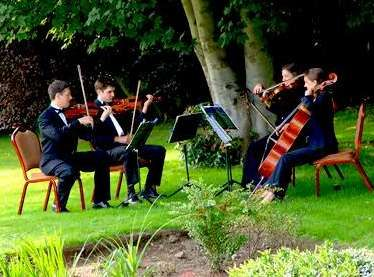 A String Quartet Is Always Classy Touch For An Outdoor Wedding