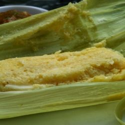Humitas are savory steamed cakes made from freshly ground corn, onion, garlic, cheese, eggs, and cream.