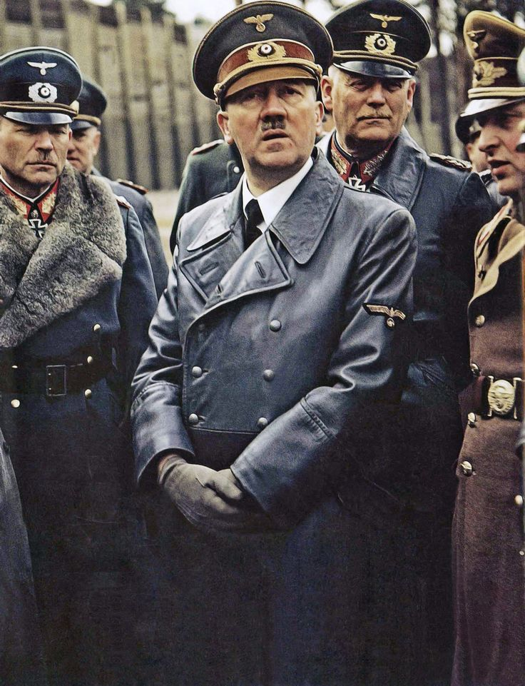 This is a fuller frame of an original color photograph of (left to right) Heinz Guderian, Adolf Hilter, and Wilhelm Keitel, along with others, taken at the Wolf's Lair military headquarters at Rastenburg in East Prussia by Walter Frentz (1907-2004).