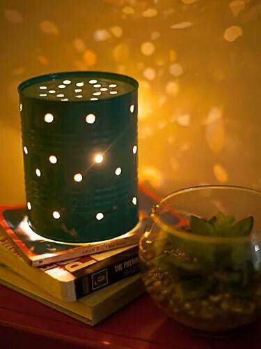 Got cans? Paint them, make some holes or designs, put a candle or a lightbulb inside and... Boom! Beautiful! :)