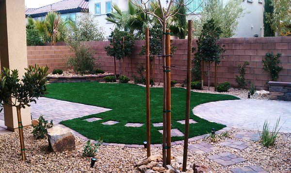 Pet Friendly Back Yard with Syn Grass, Pavers & water wise landscaping.  Designed by Donald Moore, Installed by Julian Hernandez
