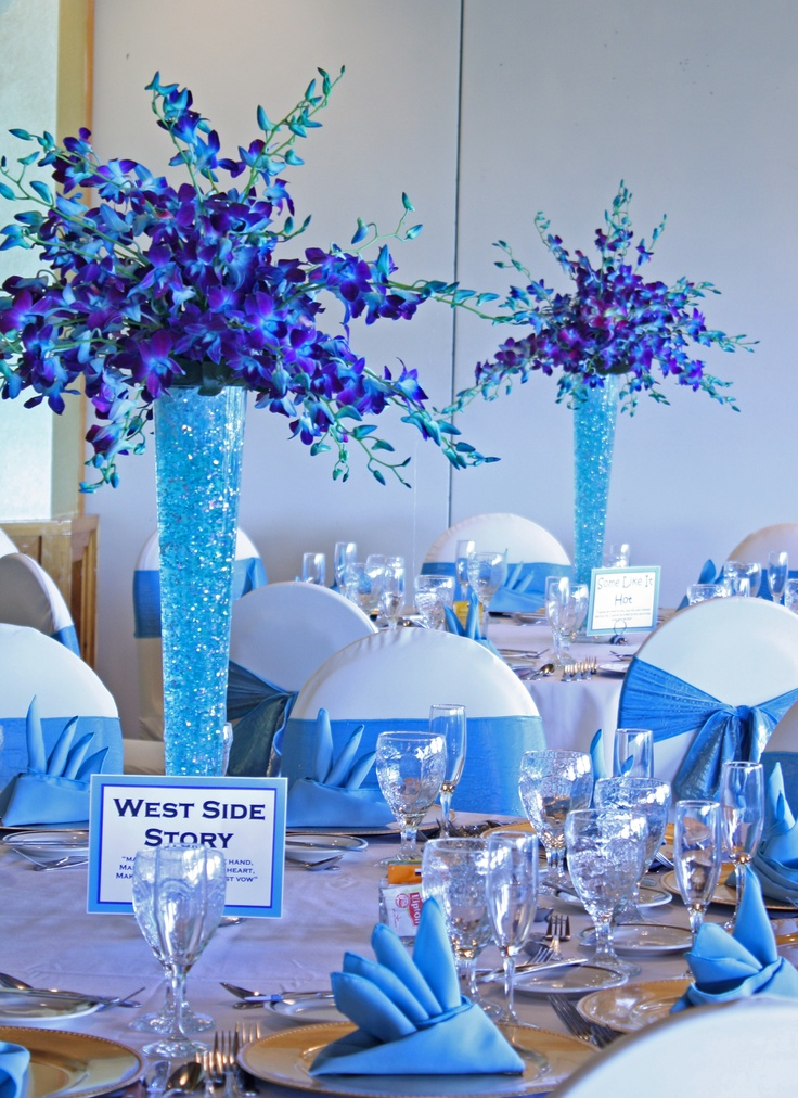 Our Purple And Turquoise Floral Centerpieces And Turquoise Lameu0027 Chair  Sashes And Table Linens Más