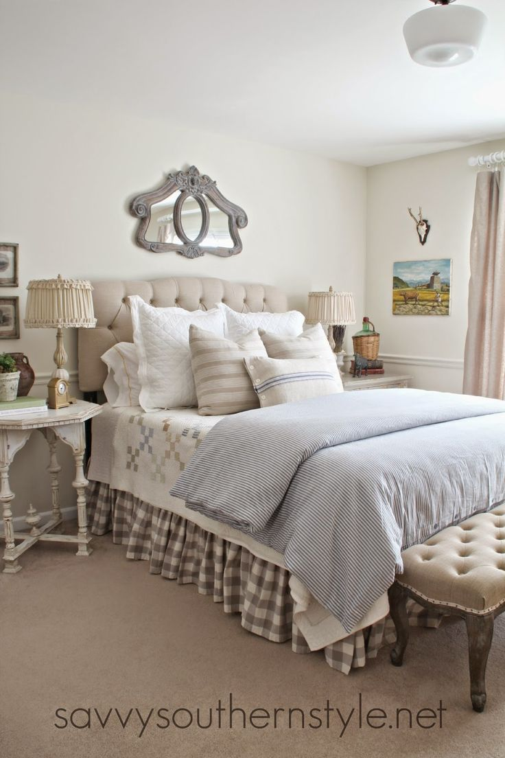 French country style, bedroom, upholstered headboard, tufted bench, Ikea duvet, Pottery Barn bedding, vintage French ticking pillows, vintage quilt, painted furniture, buffalo check bedskirt, French Laundry Home