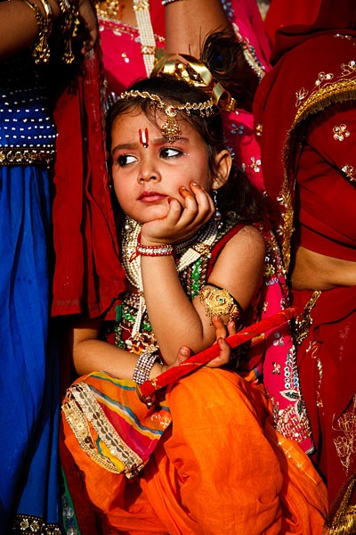 Portrait of a young girl in traditional dress during the Mewar Spring Festival, at Gangaur Ghat next to Lake Pichola