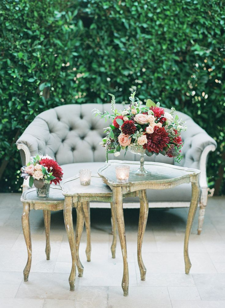 tufted seating and burgundy florals