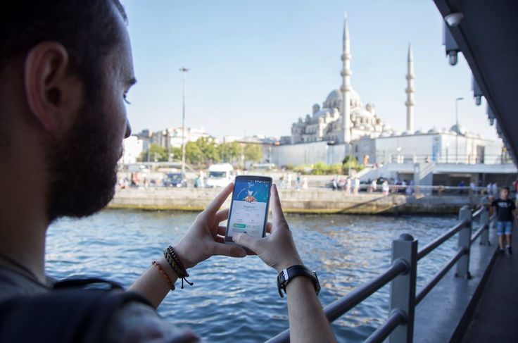 A turkish man plays Pokemon go at the Galata Bridge in Istanbul, Turkey, on July 14