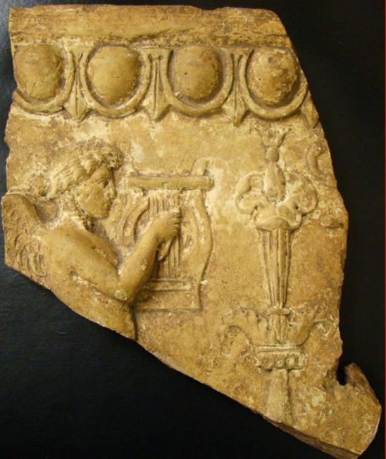 Roman terracotta relief with Cupid, 1st century B.C.-1st century A.D. Terracotta Campana relief, cupid facing right as he plays his lyre, detailed workmanship, 26 cm high. Private collection For others Roman terracotta Campana reliefs please visit https://it.pinterest.com/andreacanecane/roman-art-terracotta-campana-reliefs/?etslf=26671&eq=terracotta%20camp