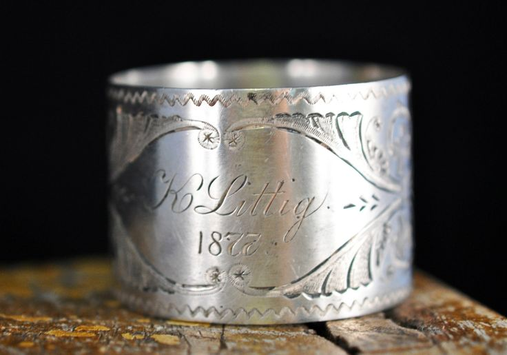 1877 Sterling Silver Victorian Napkin Ring....engraved K Littig.... This is a beautiful Victorian napkin ring, the etching is fabulous. The hand engraving is really outstanding. It is marked sterling on the inside of the ring. It is wide and heavy. It weighs just over one once. This is a fabulous Victorian napkin ring with wonderful etching, so please see the photos. It i in very nice condition. I love using Victorian napkin rings at all of our family gatherings. We have more sterling…