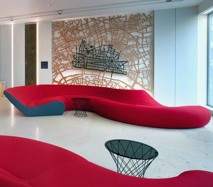 Office Interior Design >> Unique sofa designs > This slinky red sofa provides an eye-catching feature in this office reception area. The curved red lines of the sofa contrast against the white walls and floors which is reflected in a second red sofa opposite. This is a great example of how unique or unusual office furniture can be used to create a striking interior office design. See more great office design ideas and examples in our gallery of office design inspiration.