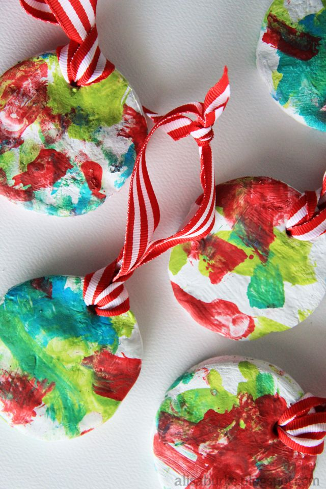 Have a toddler paint on ornaments for Christmas gifts.