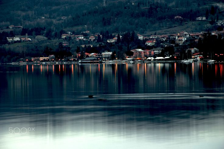 Lake Viverone - Night view of Lake Viverone, with the first light reflected on the water.