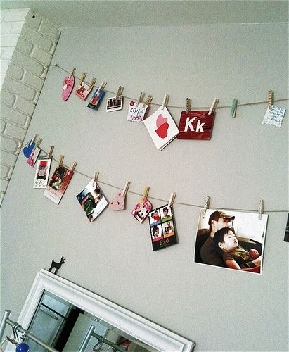 Clothespin. photos on string. Bedroom Wall idea.
