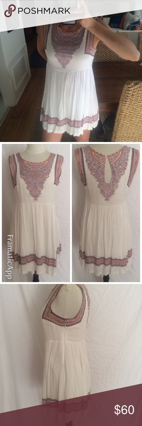 Free People White Dress Free People white dress with colorful design. It zips up the side and has a button clasp on the side. In good condition but there is a very small stain on the front as shown in the picture. Free People Dresses Mini