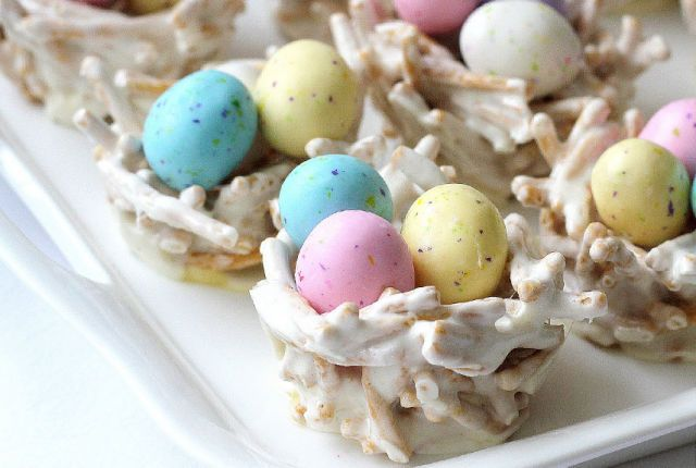 "These edible springtime ""bird nests"" are actually made from marshmallows and chow mein noodles—fill 'em up with Whoppers Robin Eggs candy for full effect!"