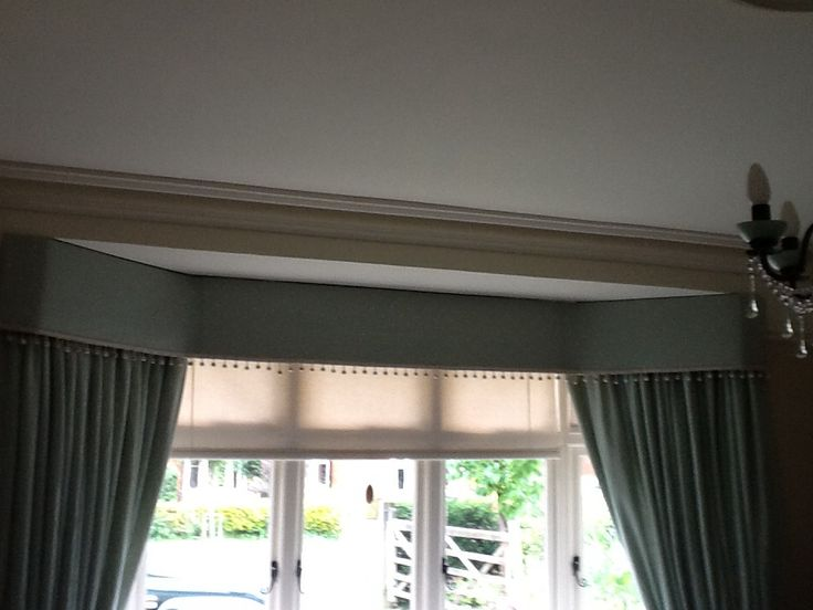 Bay window pelmet with floor curtains and roller blind