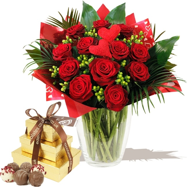 Romantica Luxury Red Roses & Chocolate Tower. This is a fabulous luxury hand-tied bouquet of a dozen large head passionate red Roses with one of our sumptious Eden Luxury Chocolate Towers. www.eden4flowers.co.uk