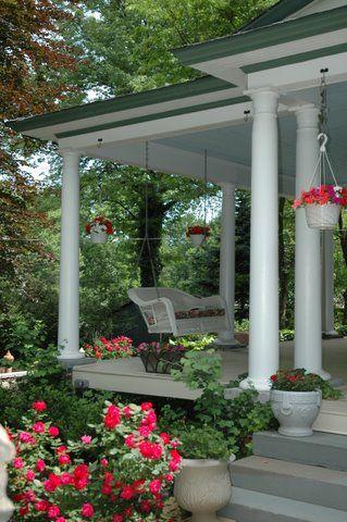 Wicker Swing on Porch at Bed & Breakfast Inn