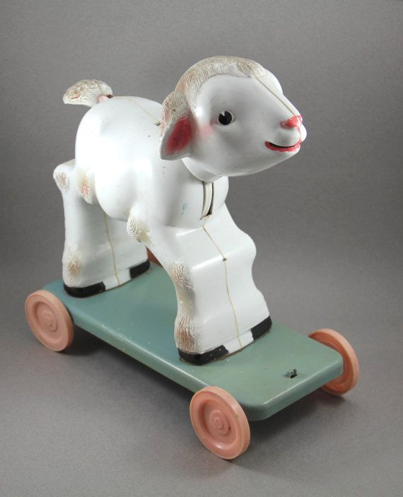 Knickerbocker Plastic Co. lamb pull toy, circa 1940s-1950s.