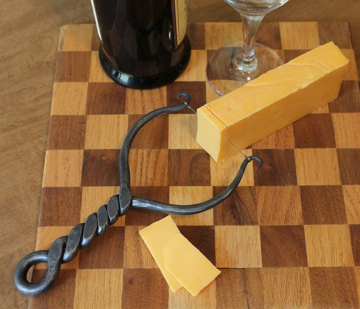 Handforged twisted iron handle cheese cutter.