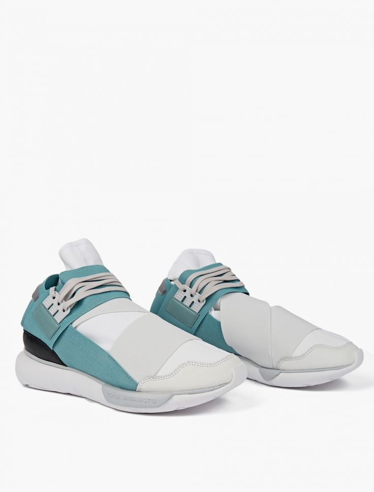 The Y-3 QASA High Sneakers for SS17, seen here in Vapor Steel. As part of the ongoing collaboration between revered Japanese designer Yohji Yamamoto and adidas, Y-3 present the updated QASA High Sneakers in a unqiue vapor steel colourway for SS17. Featuring a wide elastic panel detailing and lace-up closure, the sneakers are finished with a distinctive tubular sole and Y-3 branding to the tongue.
