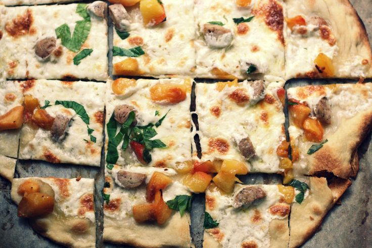 Sausage and peach pizza with basil; swap peaches for nectarines