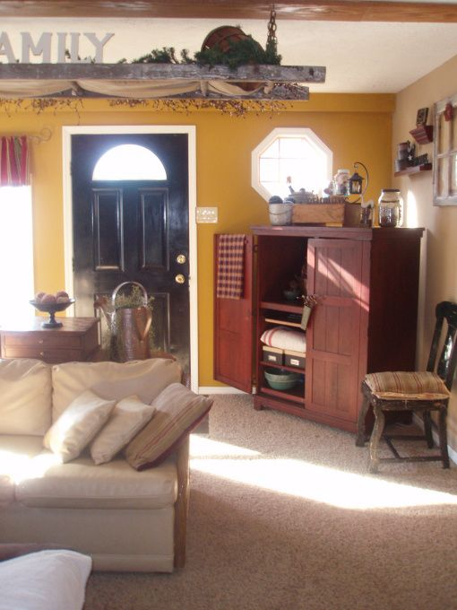 Primitive Living., This is my tweaked living room. I changed all the furniture around after having my space up on RMS. I am making shutters for the other two windows to match the window behind the couch. I love clutter and the primitive style. No snippy comments please. Suggestions from those who like this style are welcome because I have used so many of them allready. , , Living Rooms Design