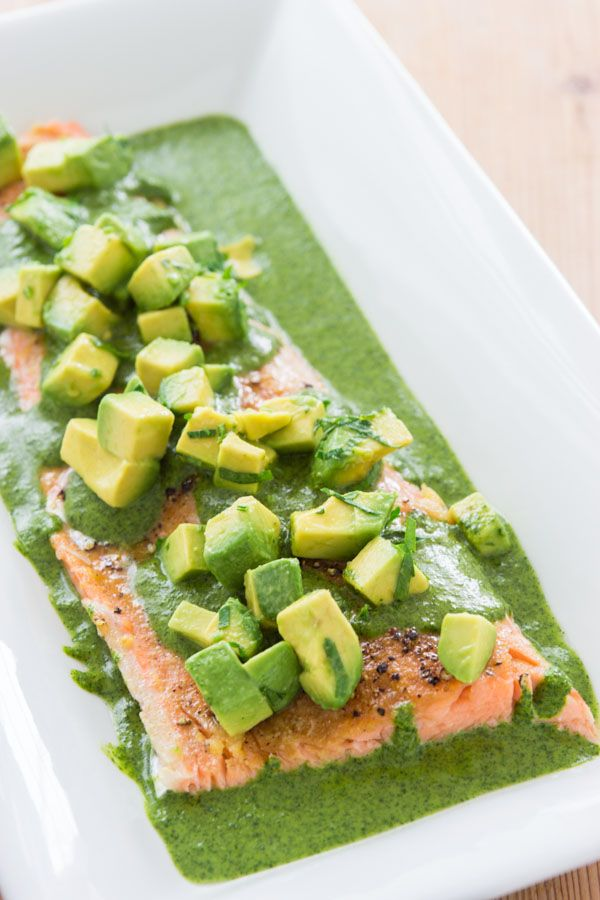 680 grams side of salmon 2 tablespoons olive oil 3 cloves garlic grated 1 lemon 1 teaspoons coriander powder 1/2 teaspoon salt black pepper 30 grams cilantro 20 grams flat leaf parsley 1/4 cup extra virgin olive oil 1 clove garlic 1/2 teaspoon salt 1/4 teaspoon ground white pepper 1 avocado pitted, peeled and cut into cubes