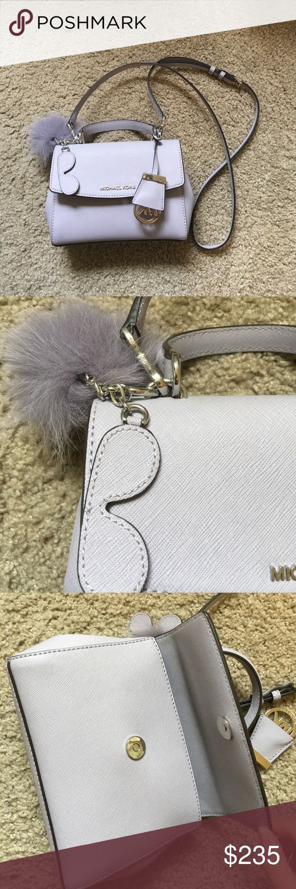 MK nano size bag Cute purple color. Can fit iPhone 7plus. Condition: like new. Come with a MK key chain showed on 2nd picture. Michael Kors Bags Mini Bags