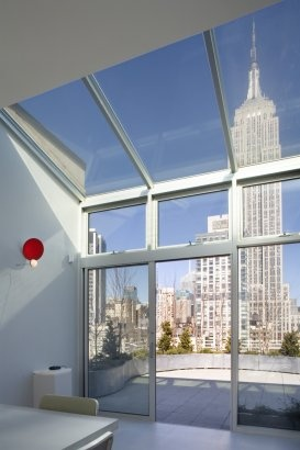 Loft with magnificent window views of the Empire State Building.