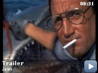 Jaws (1974 ~ Director: Steven Spielberg. Stars: Roy Scheider, Robert Shaw & Richard Dreyfuss) When a gigantic great white shark begins to menace the small island community of Amity, a police chief, a marine scientist and grizzled fisherman set out to stop it.