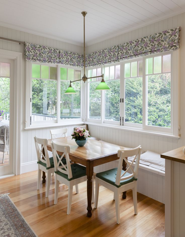 Sliding windows with colonial bars and coloured glass for a traditional look and feel by by Against the Grain Windows & Doors - a lovely light and bright country dining room!