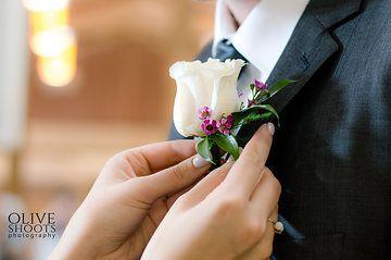 Elegant, soft, simple boutonniere for the groom.  Vendela rose, waxflower, italian ruscus...