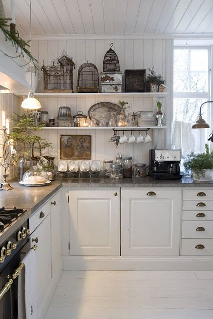 Love the open shelves, the wall board that extends across the ceiling, white cabinets w/gray counters.