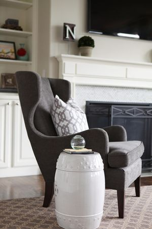 Salt Lake City refined, rustic & cozy living room designed by Jana Bek Design & as featured on Pottery Barn's Blog. Follow us on Facebook at Jana Bek Design, on instagram @Jana Bek Design, & at www.janabek.com  Layered neutrals, garden stool, living room, topiary, mantle styling