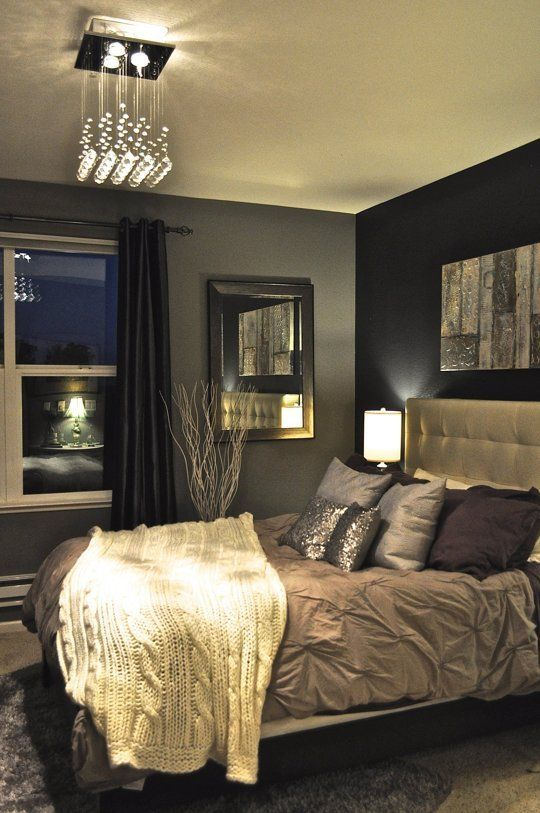 black and grey walls give this bedroom a sophisticated and luxurious look - Design Ideas For Bedroom