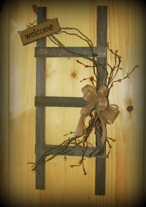 Wooden ladder made of old fence adorned with faux by for Old wooden ladder projects