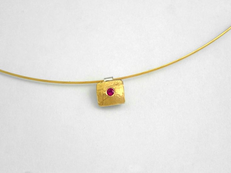 Minimal hammered gold and silver square charm with a genuine ruby and a rough surface. by TomisCraft on Etsy