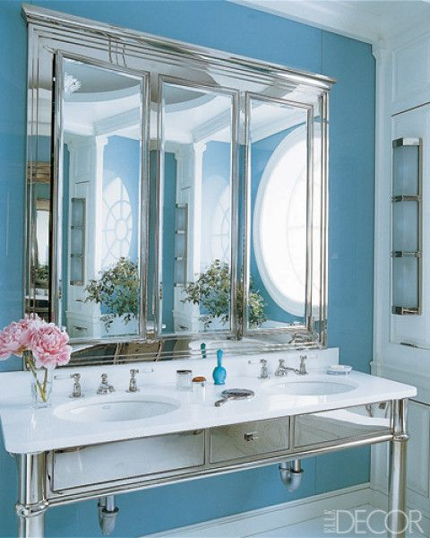 Room/Style: Bathroom, Traditional  Notes: In the master bath of a townhouse in New York City, the custom-made vanity and medicine cabinet are by Diamond Baratta Design, the Berling Triple sconce is by Ralph Lauren Home, and the walls are reverse-painted glass.