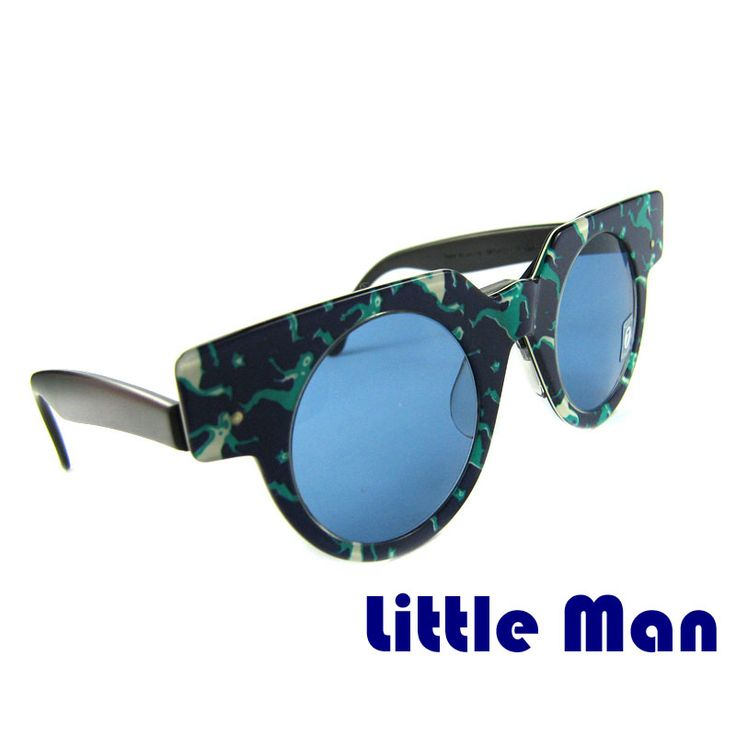 "Vintage sunglasses LITTLE MAN SWATCH  These round sunglasses are original and were made by Swatch in 1990s. The model ""Little Man"" has a dark blue frame. The frame is decorated with running men. The lenses are round with rectangular frame. The glasses are made of high quality acetate. The mask can be removed.   Price: €9.99"