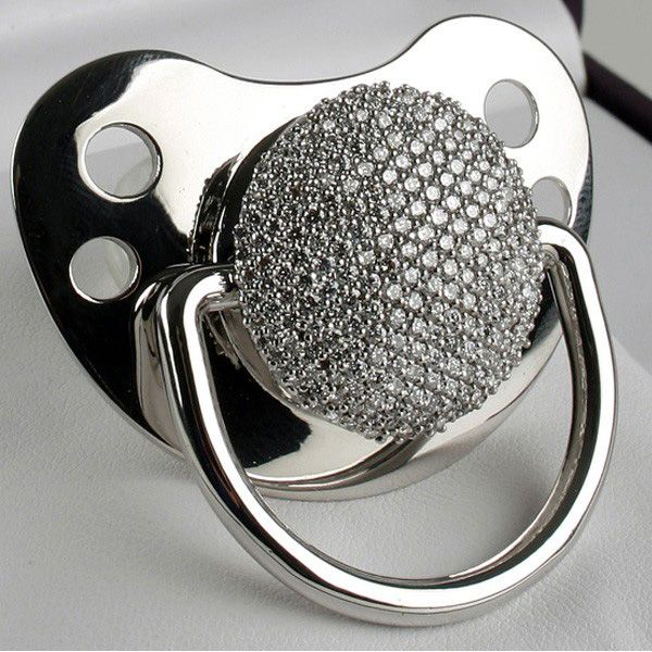 Luxury pacifier for $17,000. Has 278 diamonds decorated on white gold. Baby…