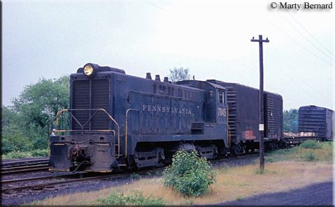 A PRR DS-4-4-660 Baldwin switcher, #7845, pulls a string of freight cars through the yard at Virginia Beach, Virginia on May 25, 1969.